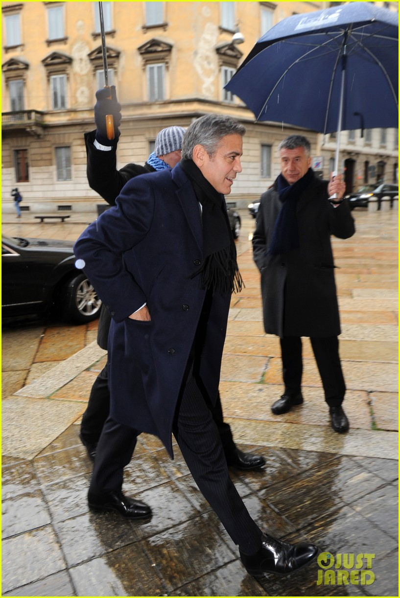 matt damon george clooney get personal umbrella holders in milan 143050722