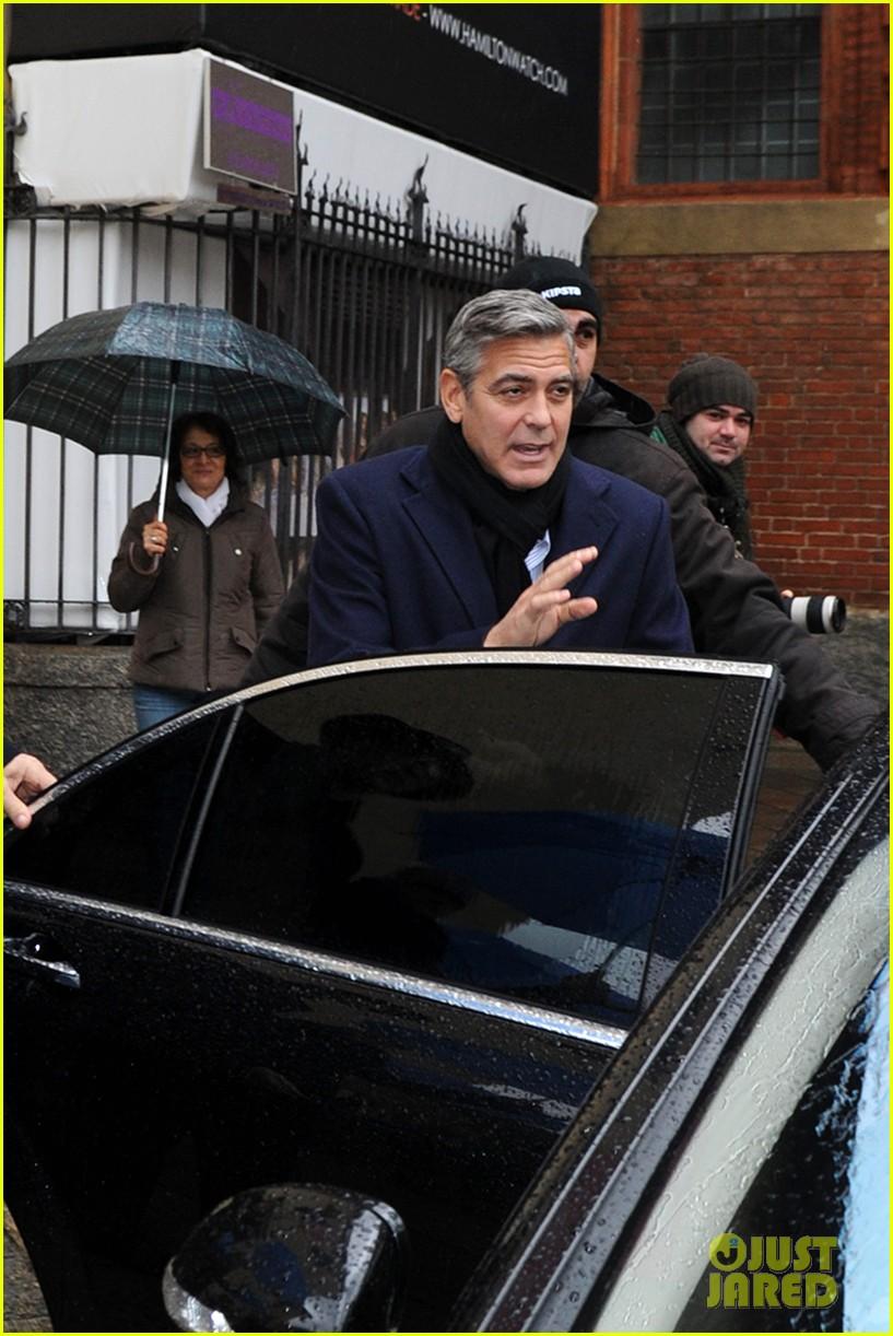 matt damon george clooney get personal umbrella holders in milan 163050724
