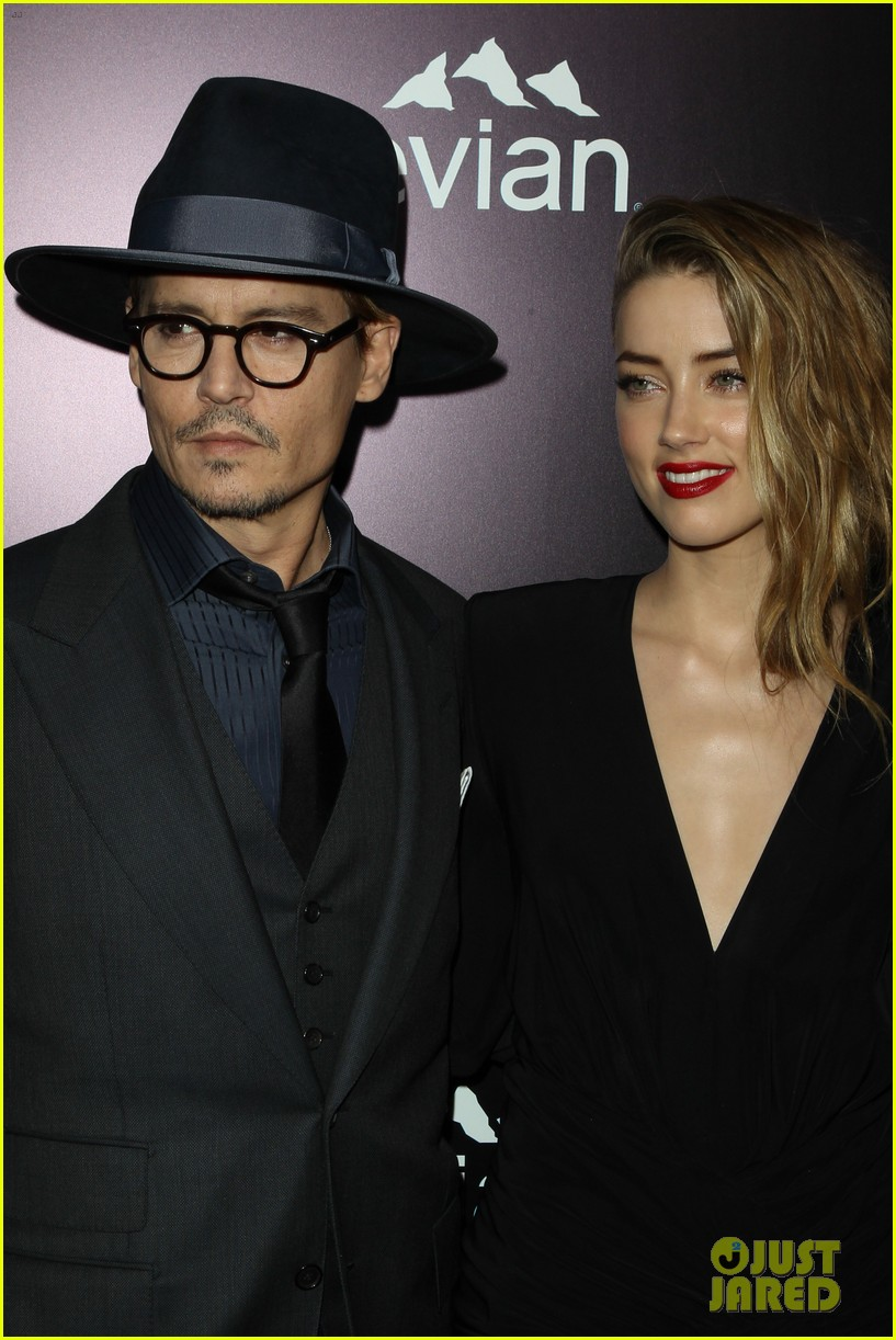 johnny depp supports amber heard at 3 days to kill premiere 103052501