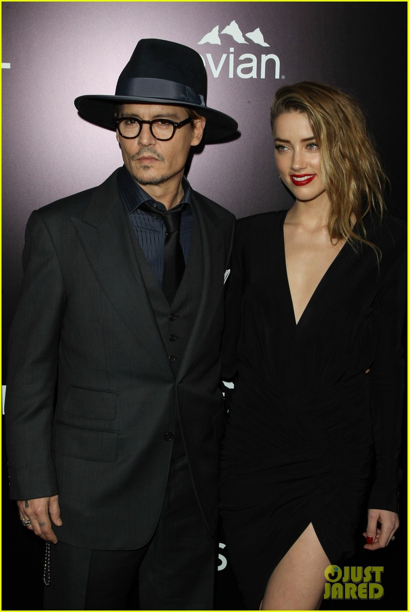 johnny depp supports amber heard at 3 days to kill premiere 113052502