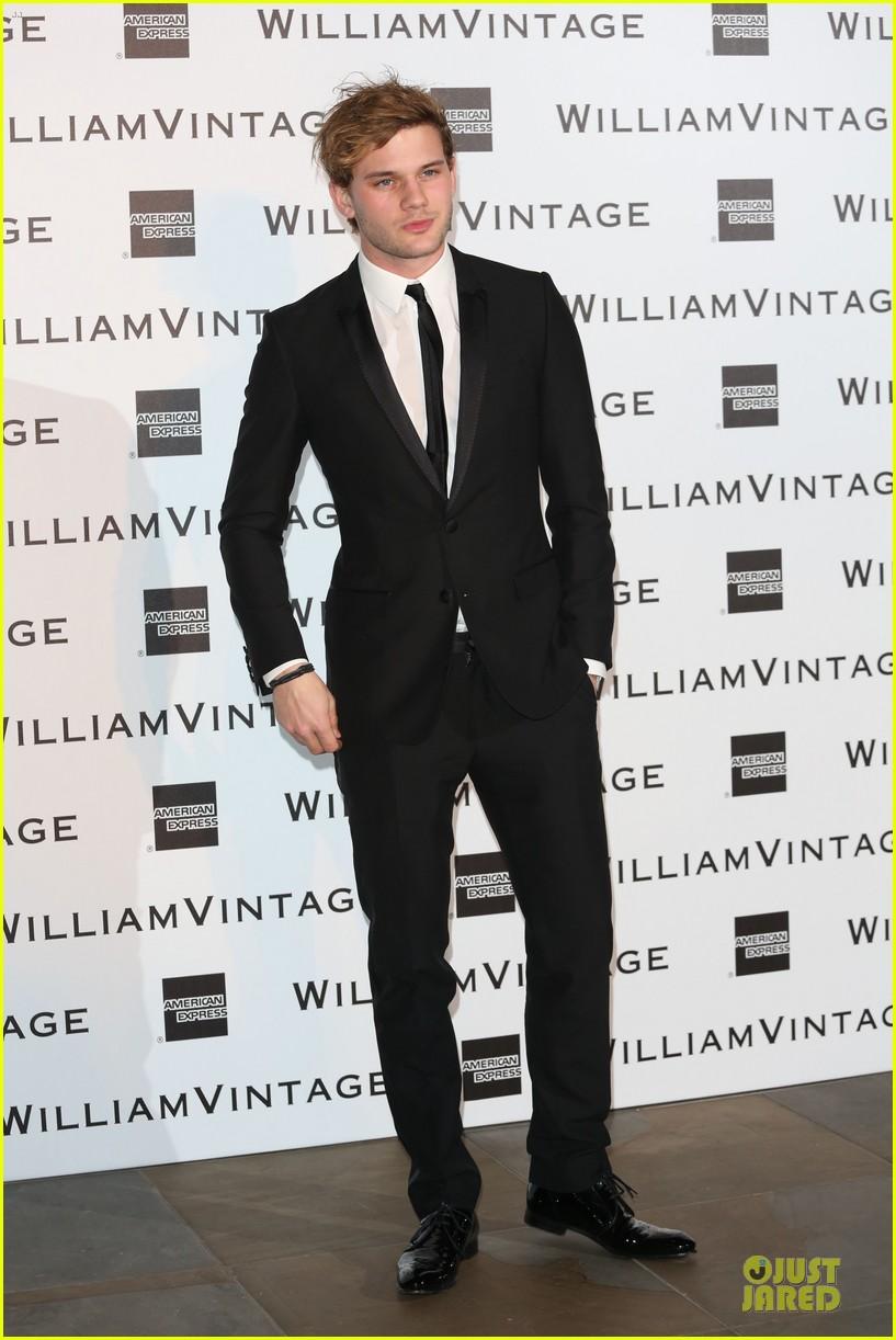 luke evans jeremy irvine suit up at williams vintage dinner 013053458