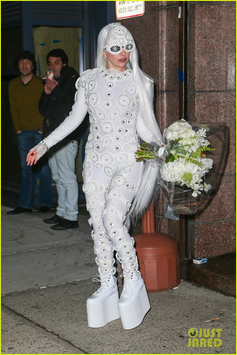 lady gaga is a bride see her throwing a bouquet of flowers 10
