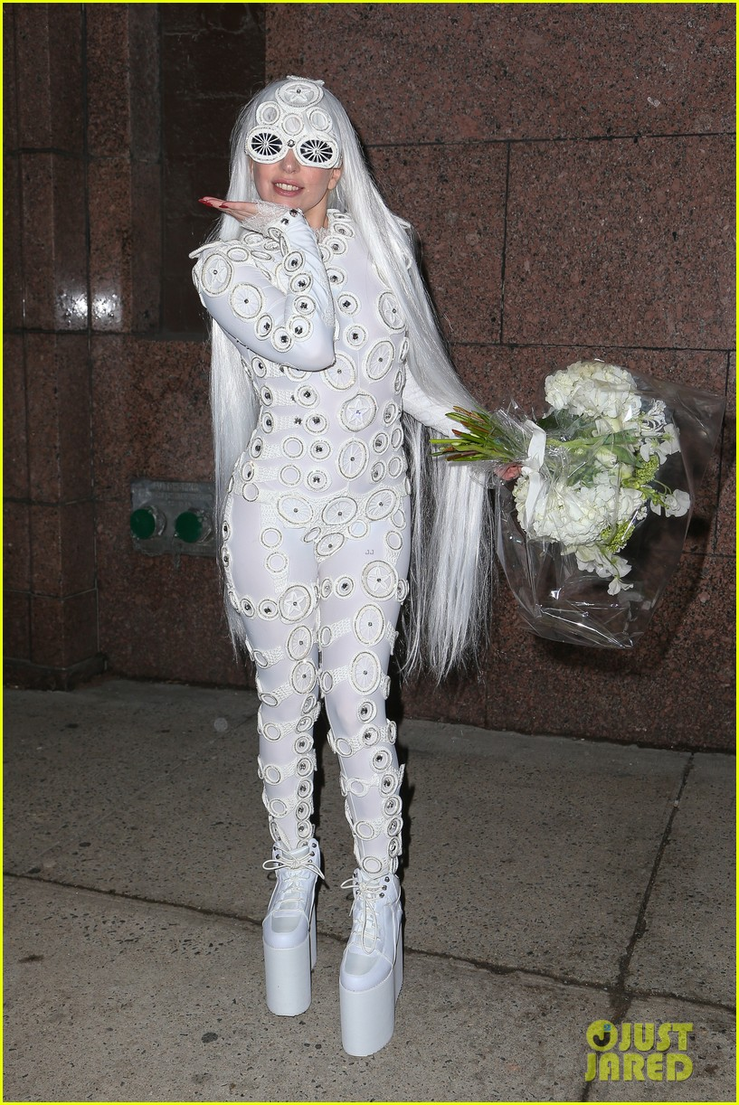 lady gaga is a bride see her throwing a bouquet of flowers 123057632