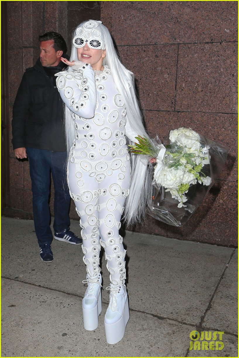 lady gaga is a bride see her throwing a bouquet of flowers 133057633