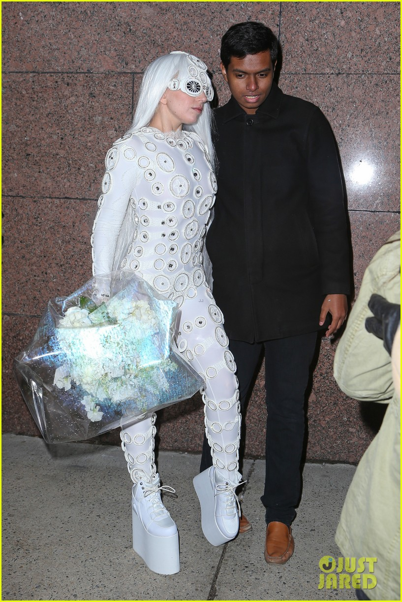 lady gaga is a bride see her throwing a bouquet of flowers 153057635