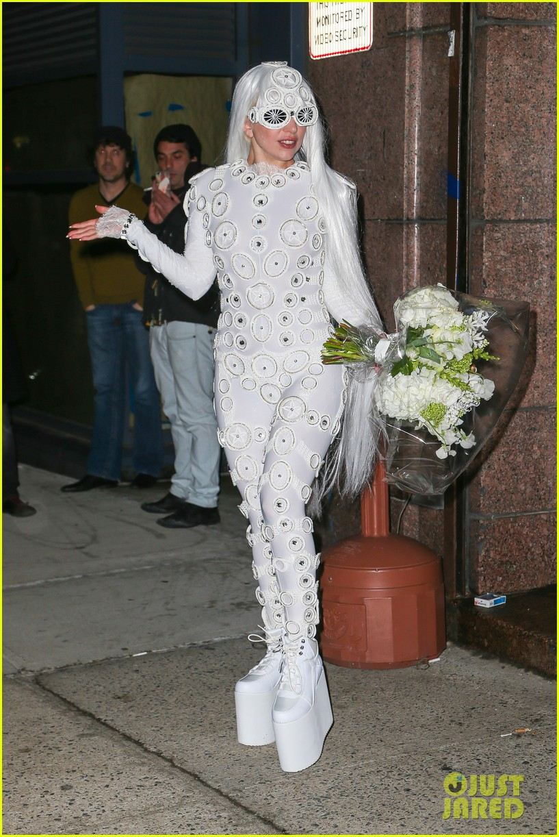 lady gaga is a bride see her throwing a bouquet of flowers 163057636