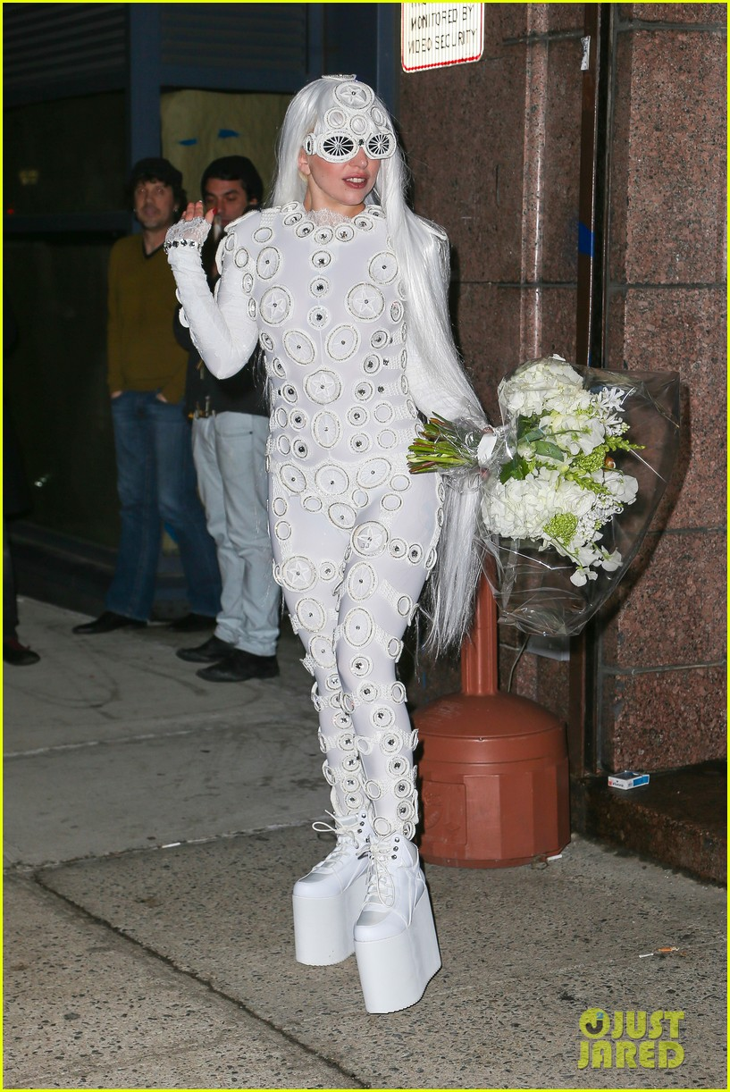 lady gaga is a bride see her throwing a bouquet of flowers 193057639