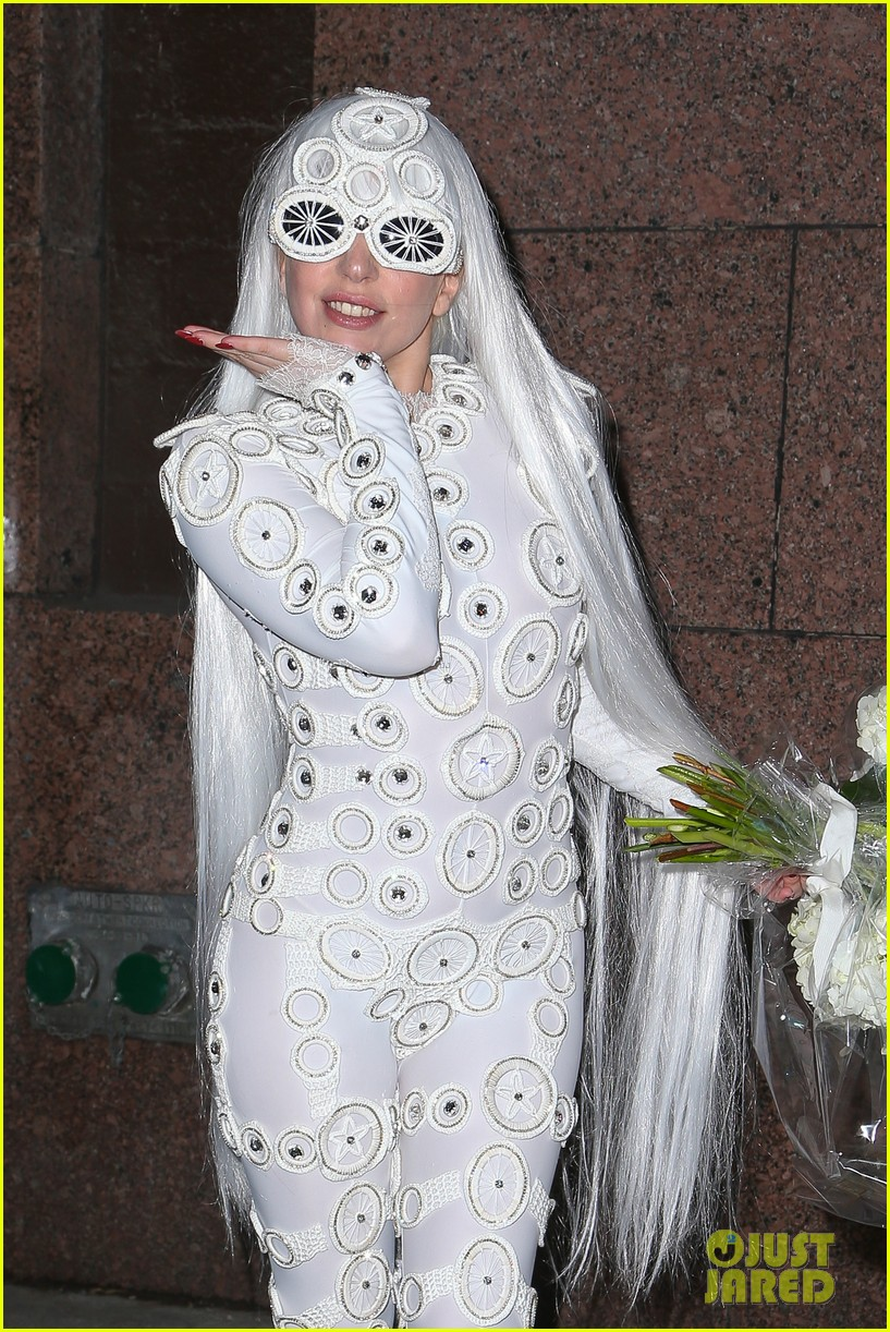 lady gaga is a bride see her throwing a bouquet of flowers 203057640
