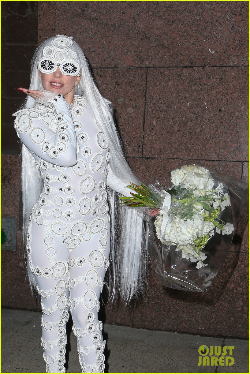 lady gaga is a bride see her throwing a bouquet of flowers 223057642