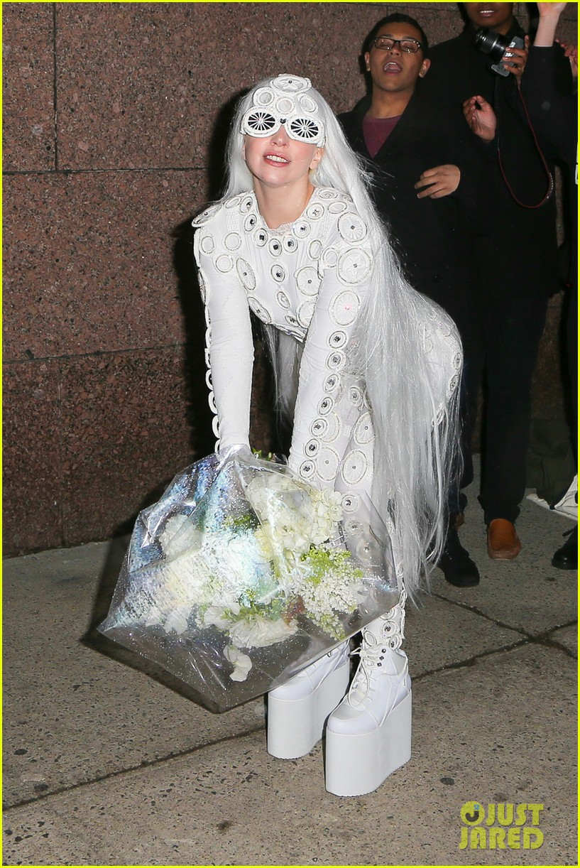lady gaga is a bride see her throwing a bouquet of flowers 243057644