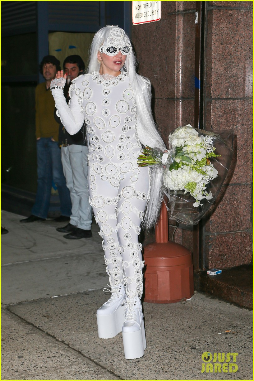 lady gaga is a bride see her throwing a bouquet of flowers 253057645