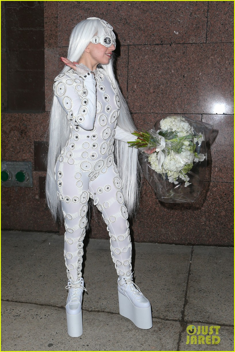 lady gaga is a bride see her throwing a bouquet of flowers 273057647