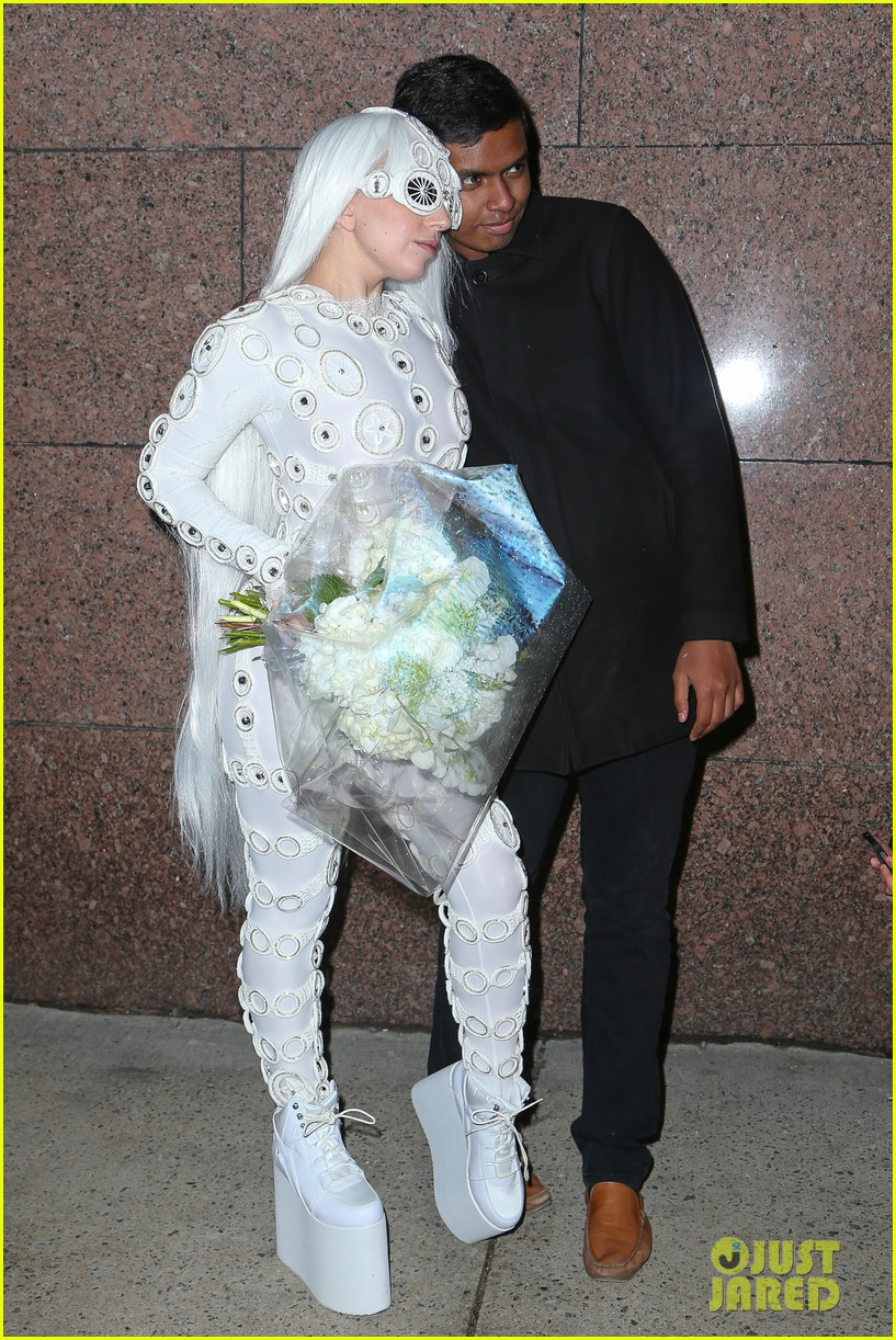 lady gaga is a bride see her throwing a bouquet of flowers 283057648