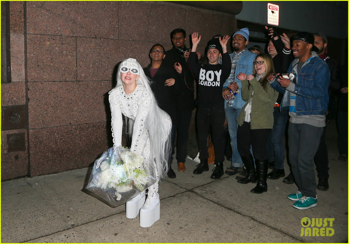lady gaga is a bride see her throwing a bouquet of flowers 293057649
