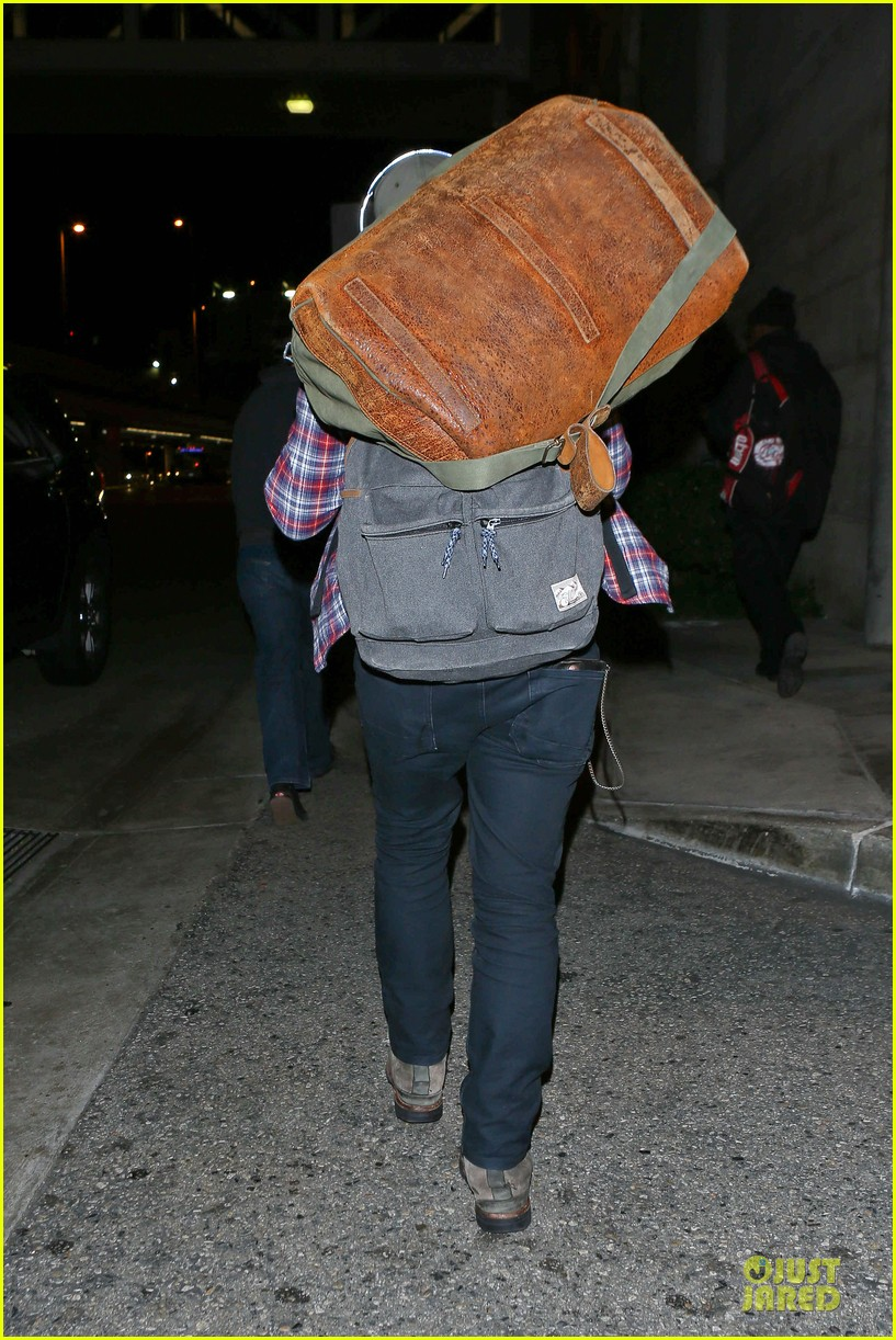 josh hutcherson shows macho strength at lax arrival 203046352