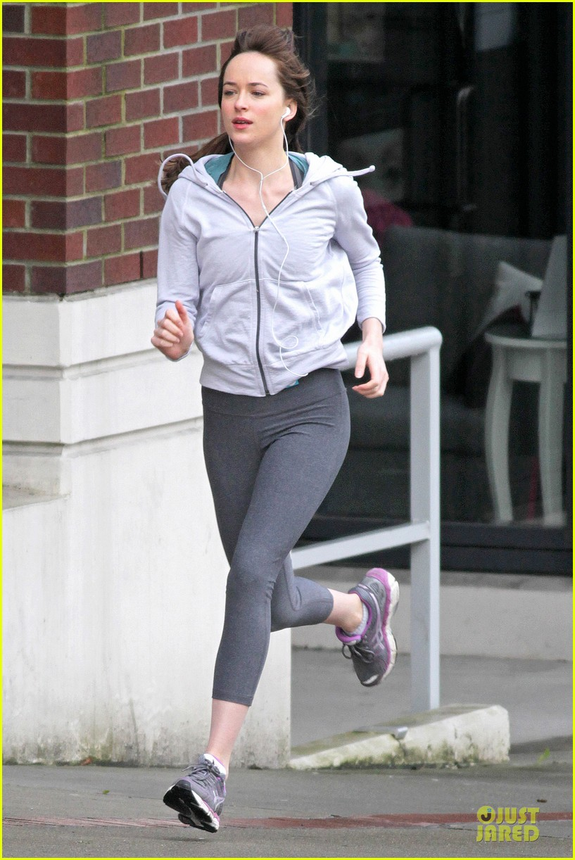 dakota johnson runs for fifty shades in pigtails 033053490