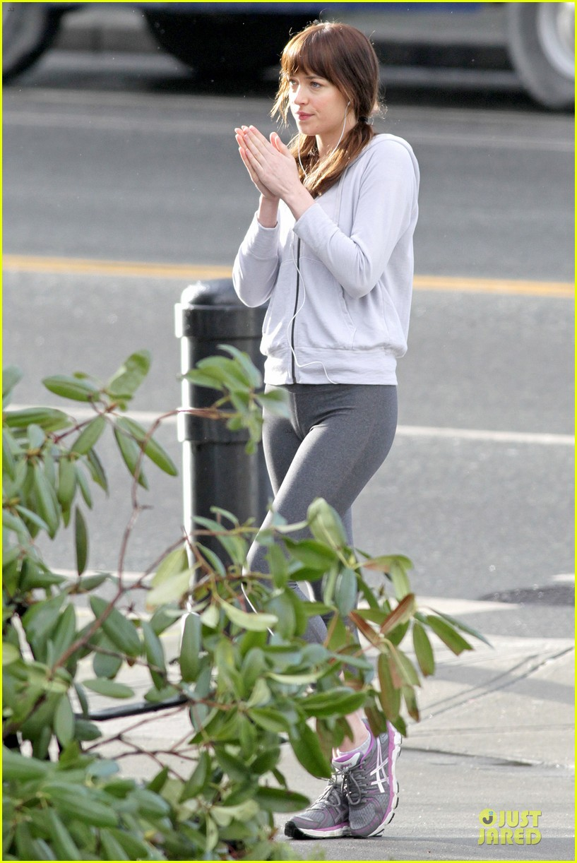 dakota johnson runs for fifty shades in pigtails 153053502