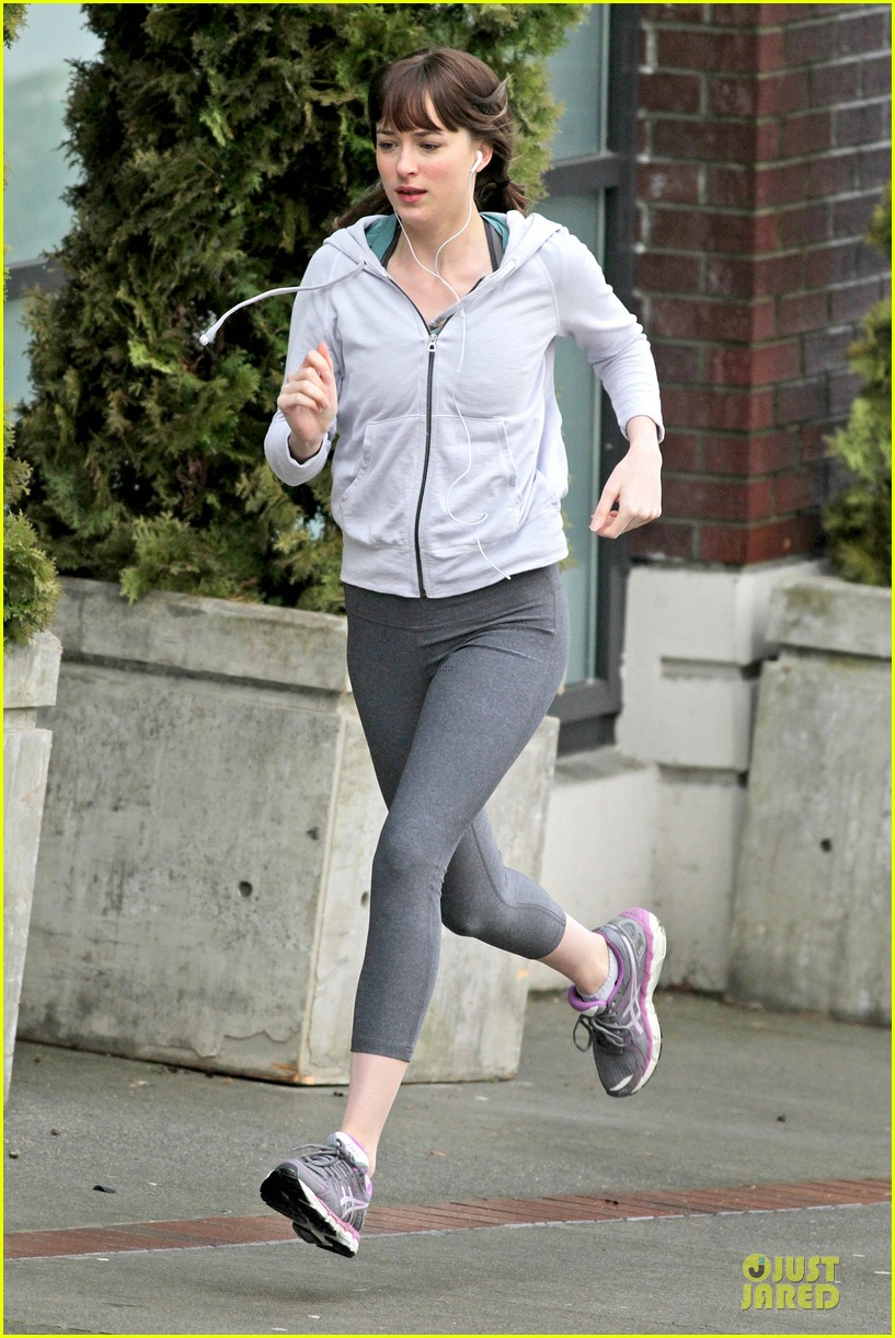 dakota johnson runs for fifty shades in pigtails 163053503
