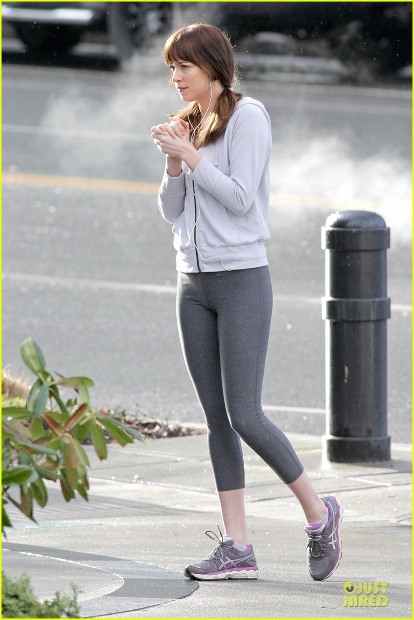 dakota johnson runs for fifty shades in pigtails 183053505