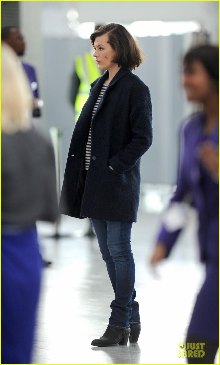 milla jovovich survivor cuts at heathrow airport 133055997