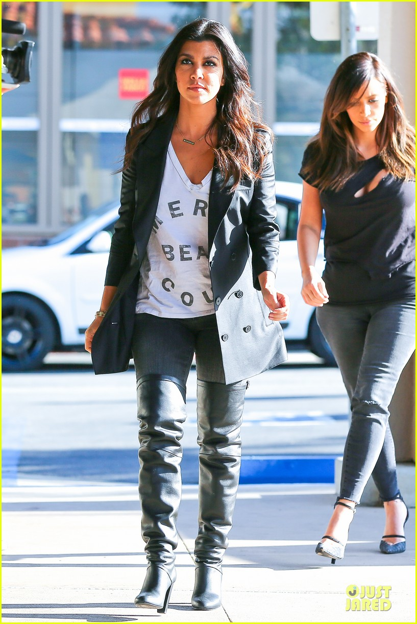 kim kardashian bares cleavage in black cut out shirt 033049291