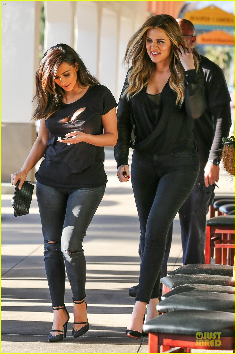 kim kardashian bares cleavage in black cut out shirt 073049295
