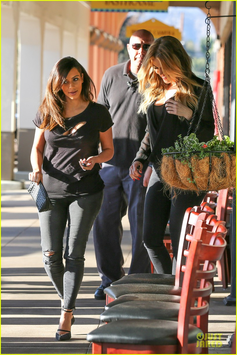 kim kardashian bares cleavage in black cut out shirt 113049299
