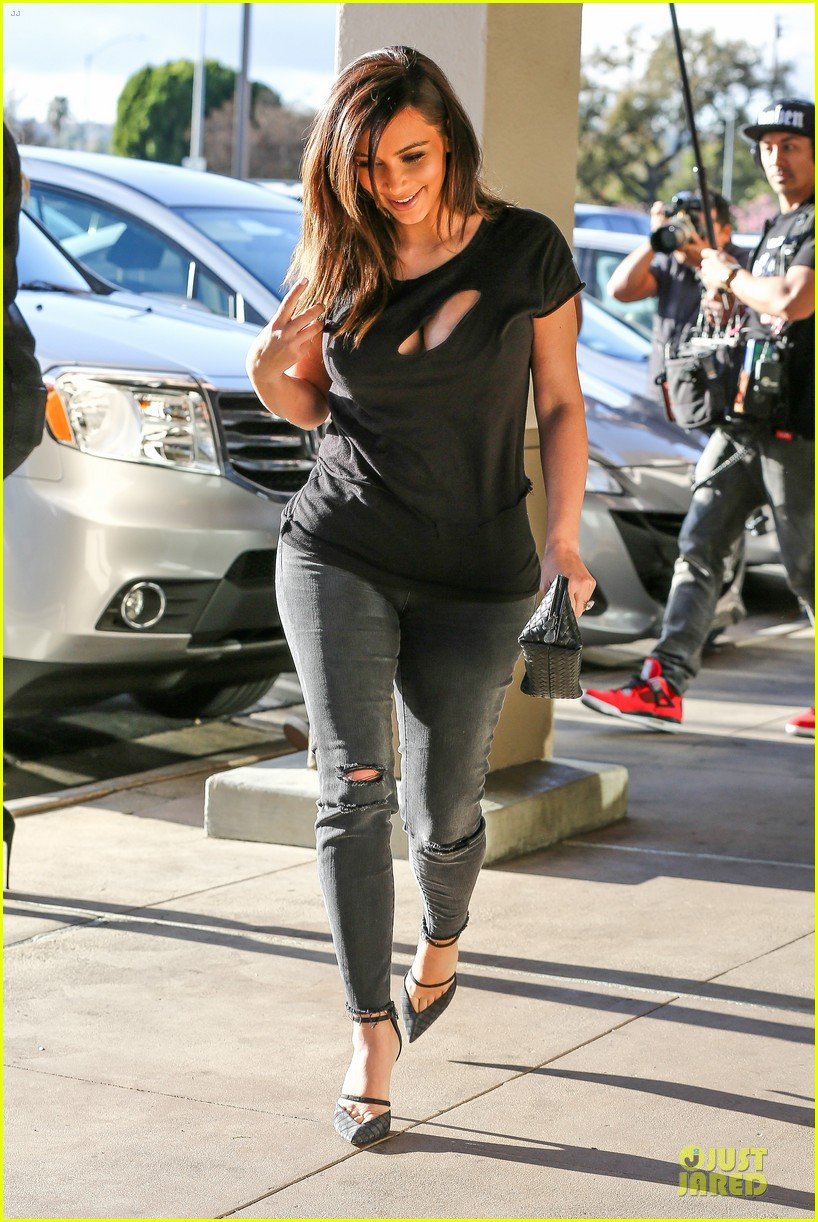 kim kardashian bares cleavage in black cut out shirt 213049309