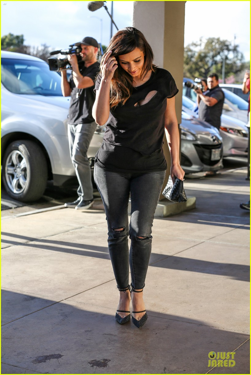 kim kardashian bares cleavage in black cut out shirt 223049310
