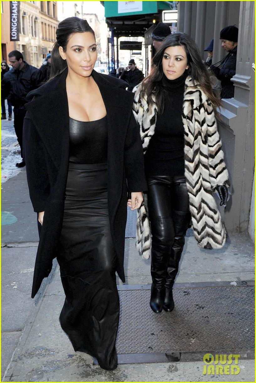 kim kardashian films kuwtk with her sisters khloe sends message on coat fxck yo fur 013055119