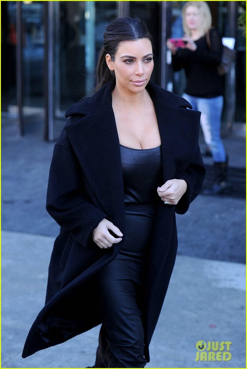 kim kardashian films kuwtk with her sisters khloe sends message on coat fxck yo fur 123055130