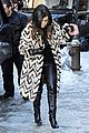 kim kardashian films kuwtk with her sisters khloe sends message on coat fxck yo fur 25