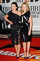 kylie minogue brit awards 2014 with sister danii 02