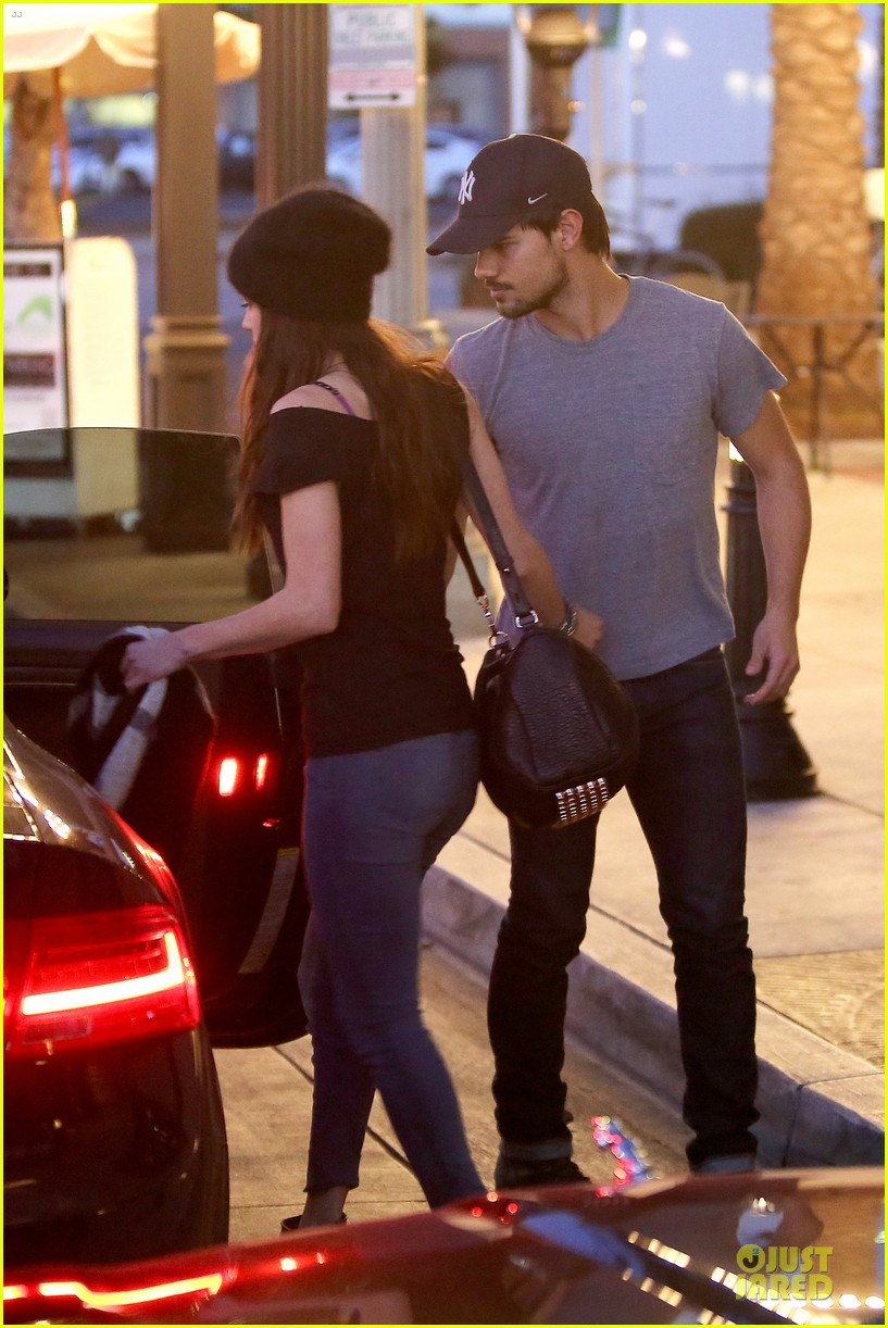 taylor lautner marie avgeropoulos hold hands for dinner 043047578