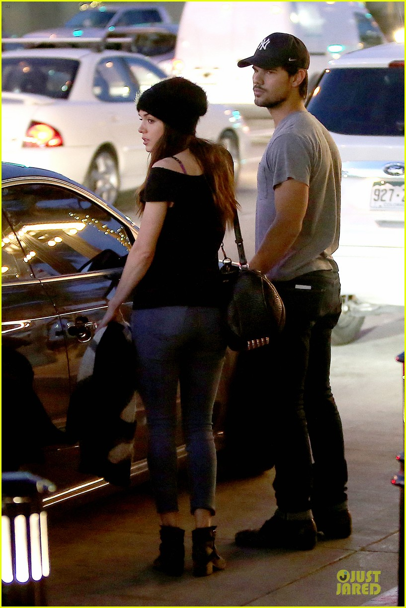 taylor lautner marie avgeropoulos hold hands for dinner 073047581