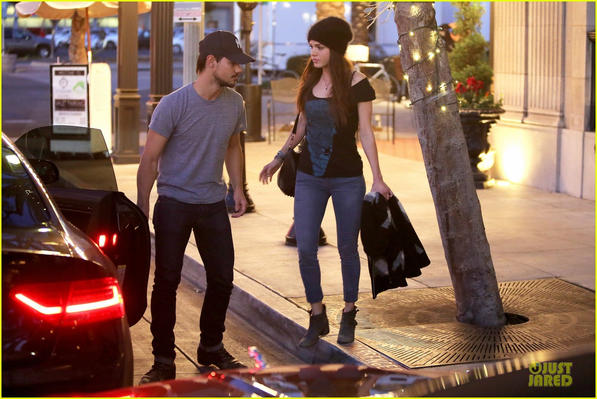taylor lautner marie avgeropoulos hold hands for dinner 083047582