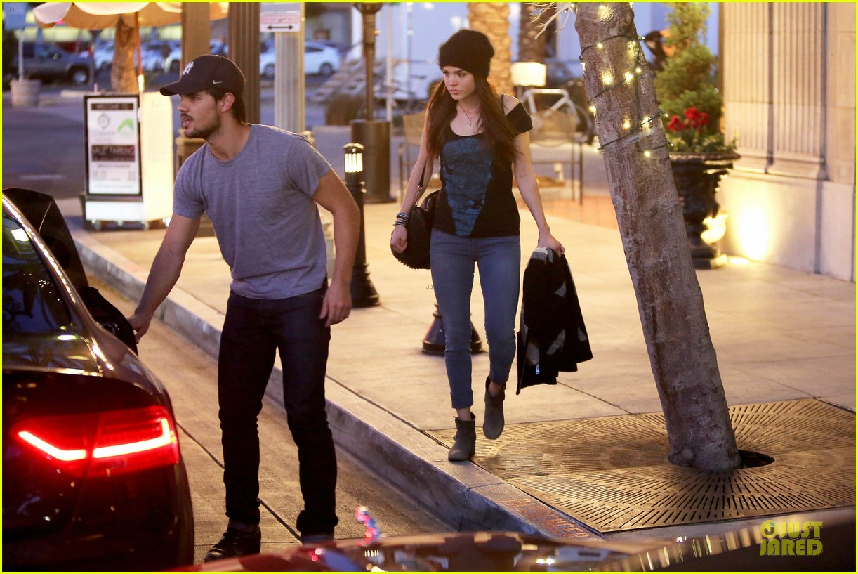 taylor lautner marie avgeropoulos hold hands for dinner 133047587