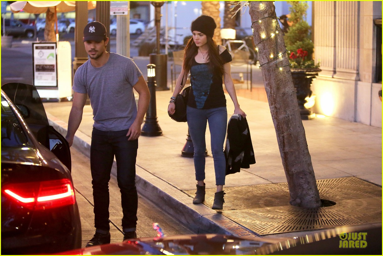 taylor lautner marie avgeropoulos hold hands for dinner 143047588