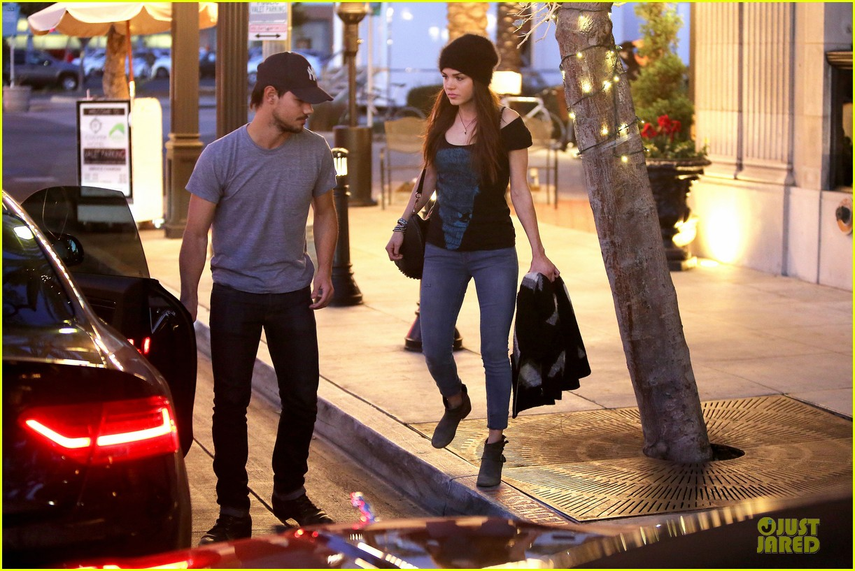 taylor lautner marie avgeropoulos hold hands for dinner 153047589
