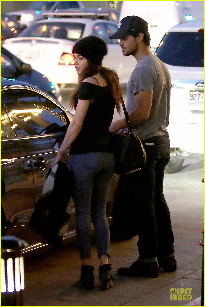 taylor lautner marie avgeropoulos hold hands for dinner 163047590