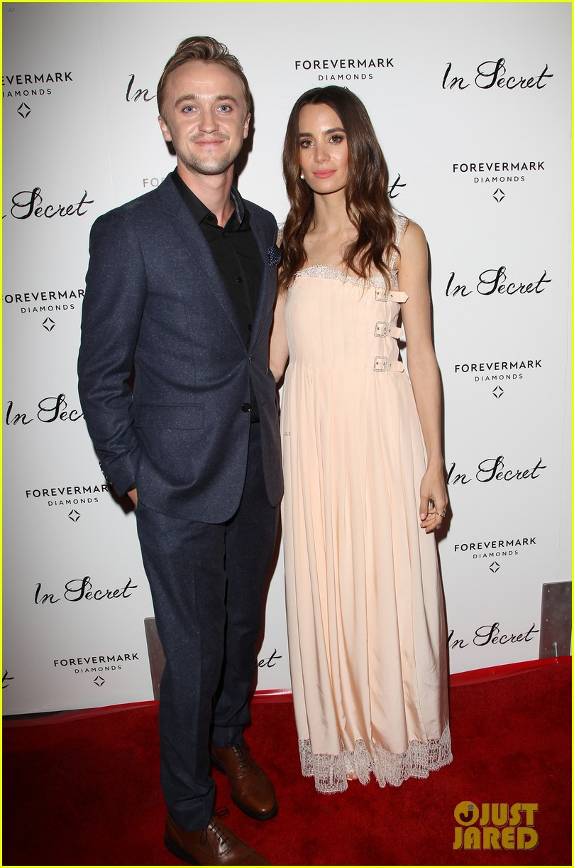 elizabeth olsen tom felton date night at in secret premiere 013048958