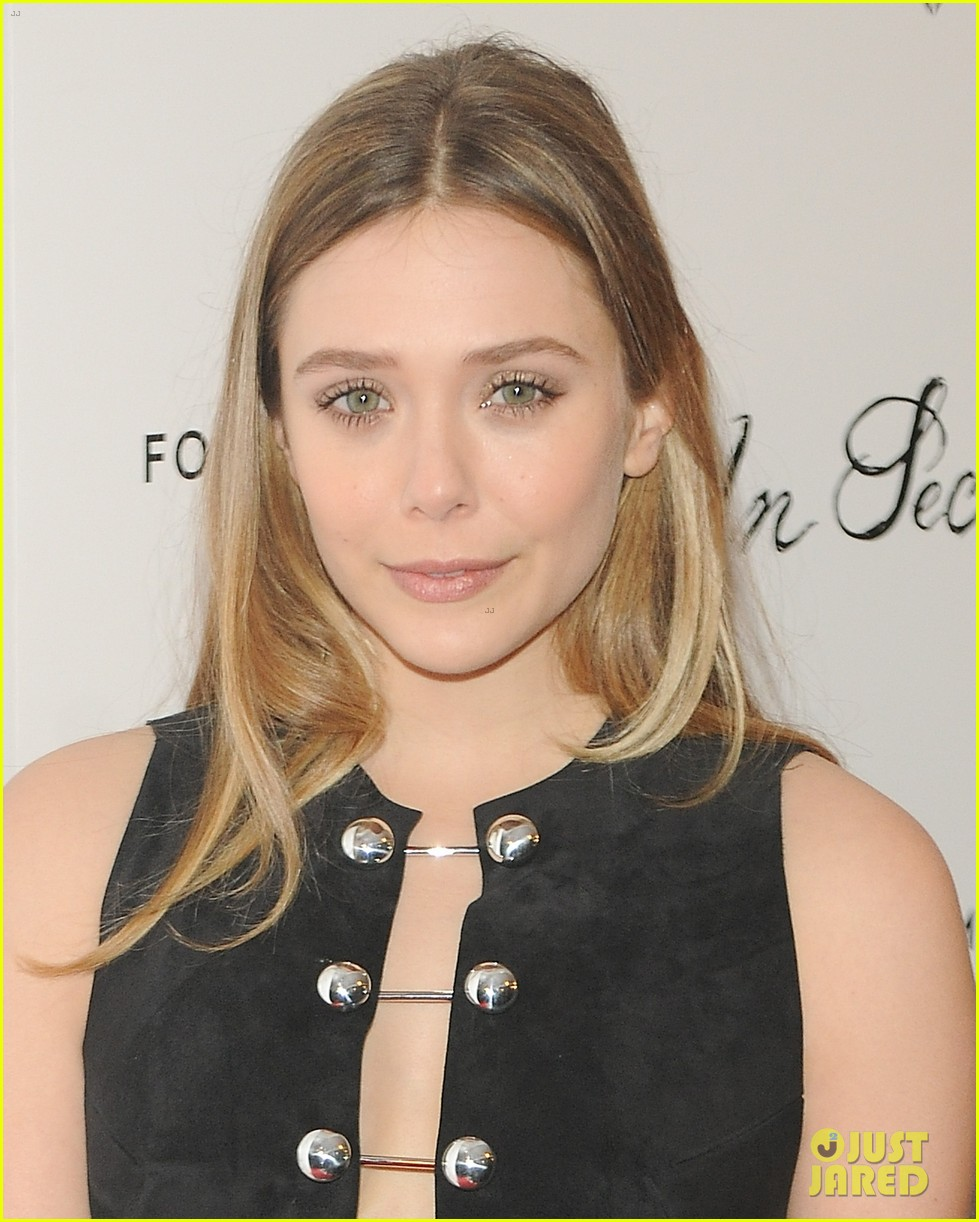 elizabeth olsen tom felton date night at in secret premiere 11