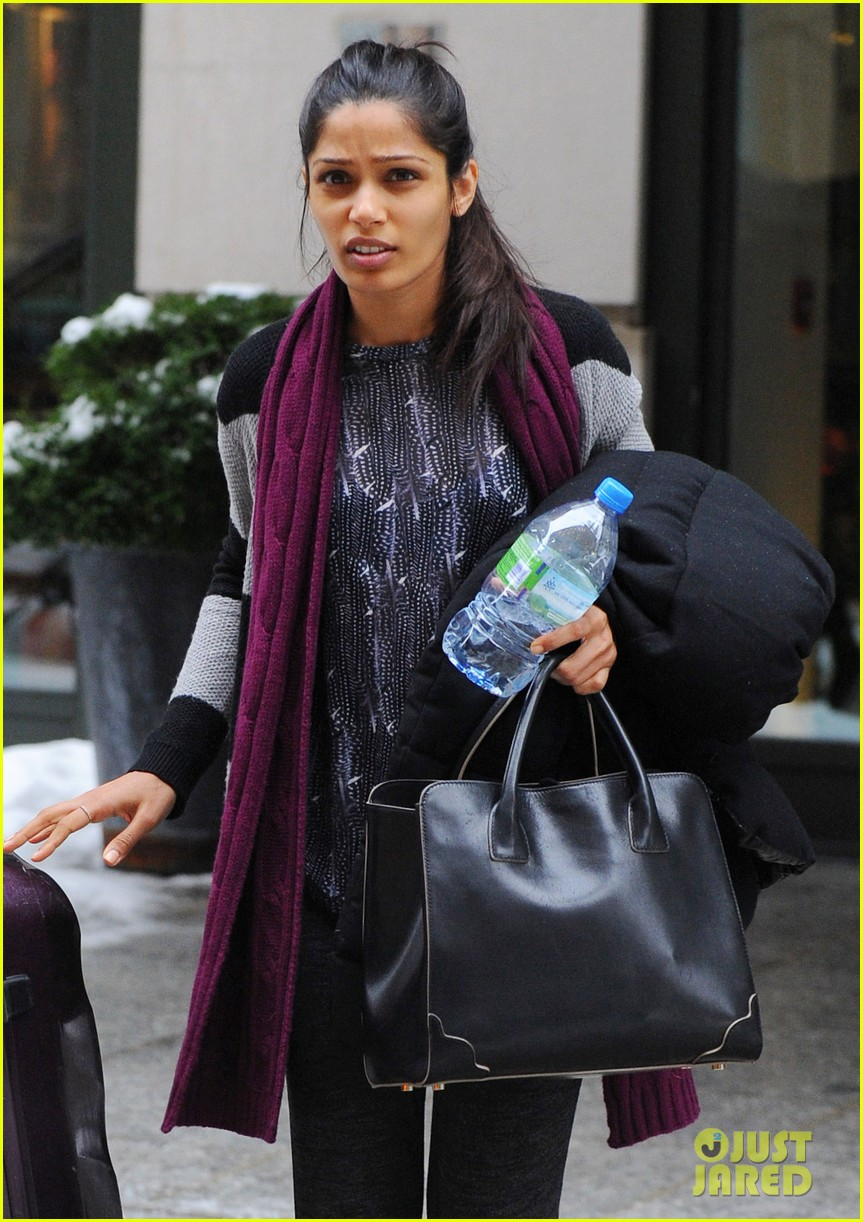 freida pinto laughs off giant snow slush piles in nyc 023053339