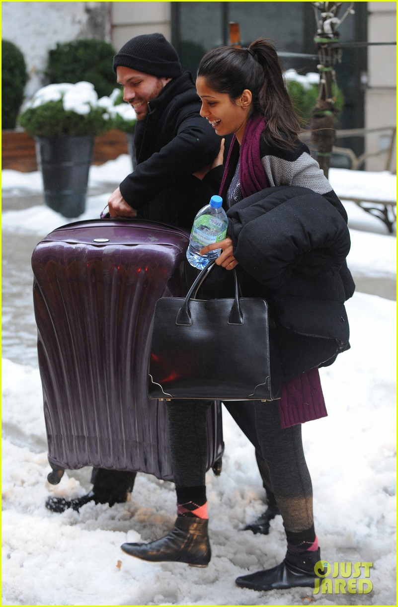 freida pinto laughs off giant snow slush piles in nyc 07