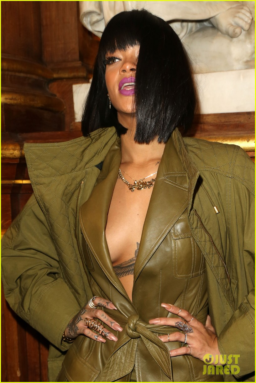 rihanna displays cleavage for balmain paris fashion show 013061614