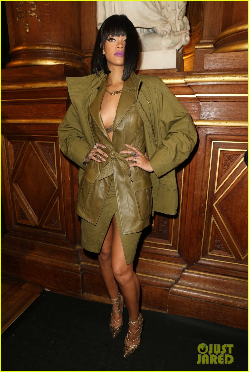 rihanna displays cleavage for balmain paris fashion show 033061616