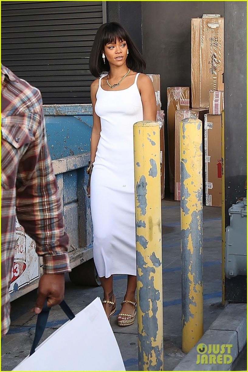 rihanna wears sleek white dress to shop at moncler 013055394