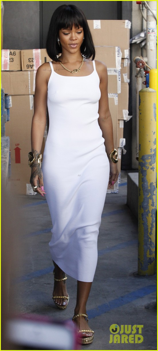 rihanna wears sleek white dress to shop at moncler 023055395