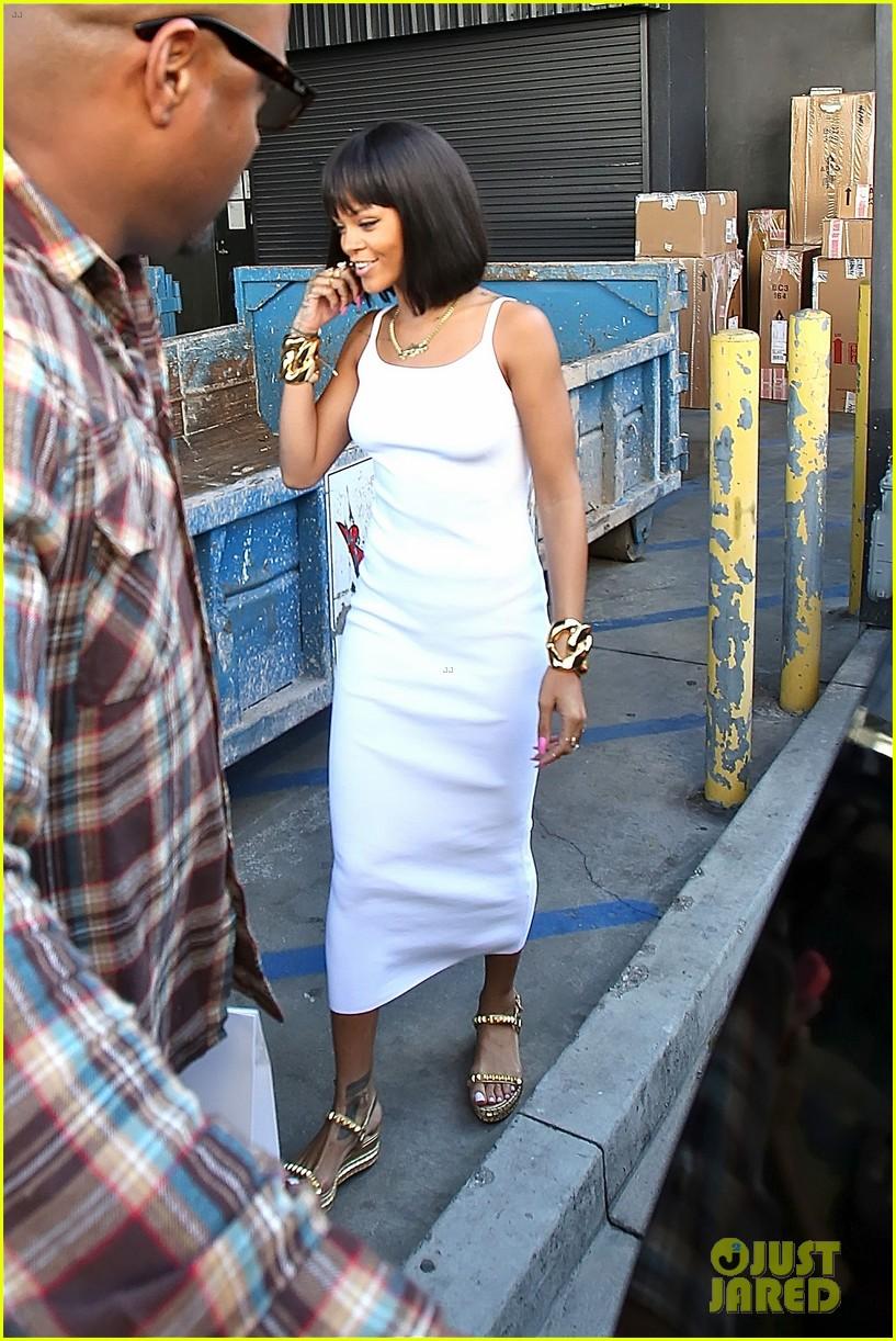 rihanna wears sleek white dress to shop at moncler 123055405
