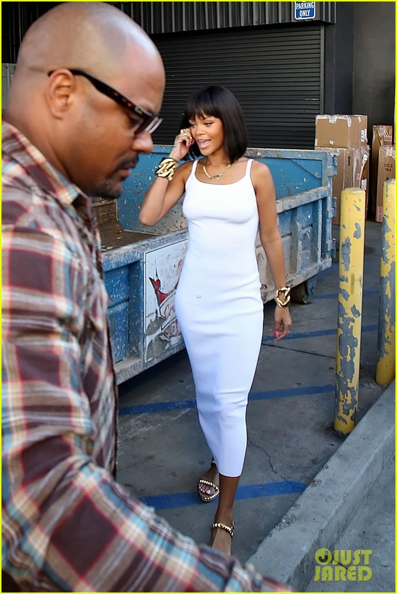 rihanna wears sleek white dress to shop at moncler 143055407